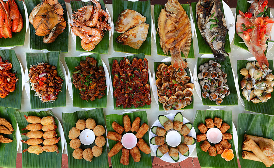 Nasi Padang - Variety of Padang dishes on Banana leaf (Top-down View)